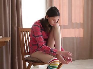 Lovely teen Ariel Tylor is effectuation with super juicy pussy spreading legs wide open